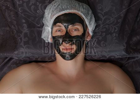 Young Man Wearing A Mask Cosmetic Procedure At The Spa