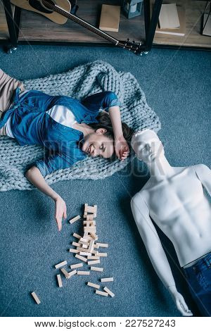 Overhead View Of Woman And Mannequin Lying On Floor Near Blocks Wood Game, Perfect Relationship Drea