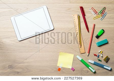 Blank Tablet With Copy Space On Desk From Above
