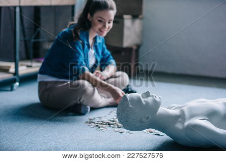 woman playing with puzzles with manikin near by, perfect relationship dream concept poster