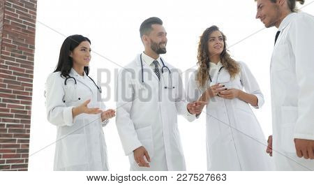 closeup of a group of doctors discussing