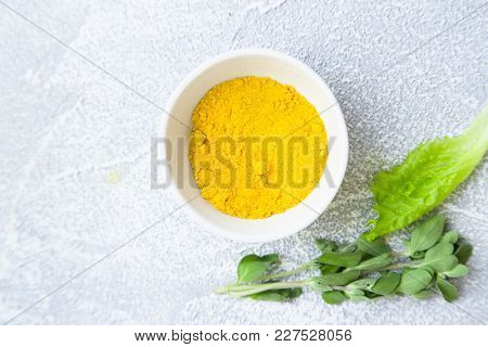 Dry Spices In A Ceramic Bowl, Fresh Herbs On A Light Stone Background With Copy Space, Top View