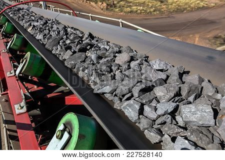Manganese Ore Rocks Moving On A Conveyor Belt For Processing