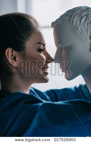 Side View Of Smiling Woman And Mannequin, One Way Love Concept