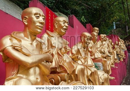 Golden Buddha Statues Along The Stairs Leading To The Ten Thousand Buddhas Monastery And Landscape W