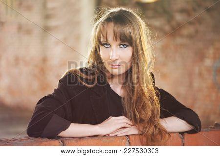 Girl recline on wall
