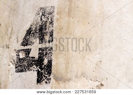 Number 4 Painted On Old Concrete Wall Background