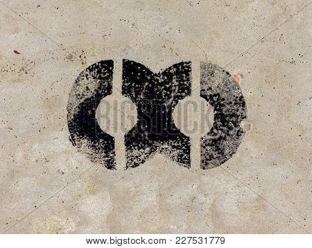 Infinity Symbol Painted Black On Concrete Wall Background