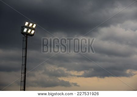 Silhouetted Stadium Lights On A Stormy Afternoon