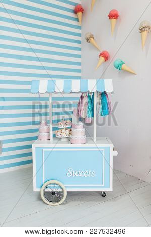 White And Blue Ice Cream Cart. Food Truck. Shop On Wheels With The Sweets. Candy Stall Photo Zone Wi