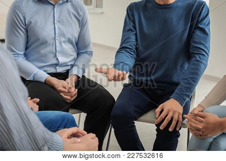 People at group psychotherapy session indoors