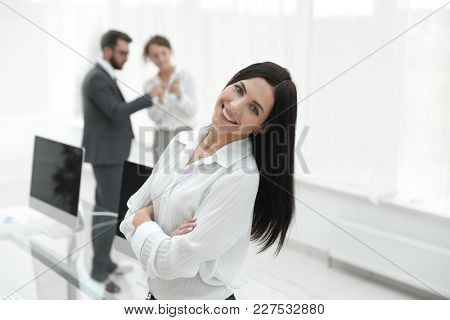 successful young business woman on the background of a workplace