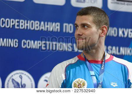 ST. PETERSBURG, RUSSIA - DECEMBER 22, 2017: Swimmer Evgeny Lagunov during award ceremony of Salnikov Cup. Lagunov takes bronze in 100m freestyle swimming