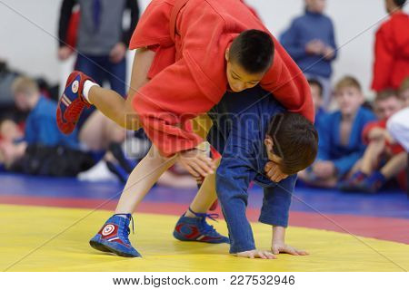 ST. PETERSBURG, RUSSIA - NOVEMBER 19, 2017: Young athletes competes in wrestling during the All-Russian Day of wrestling. The event is held annually since 2008