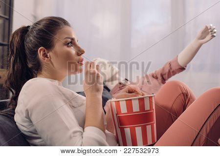 Woman Eating Popcorn While Watching Film Together With Manikin At Home, Perfect Relationship Dream C