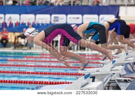 ST. PETERSBURG, RUSSIA - DECEMBER 22, 2017: Start of women 800m freestyle swimming competitions during Salnikov Cup. The Cup is recognized as a preliminary of World Short Course Swimming Championship