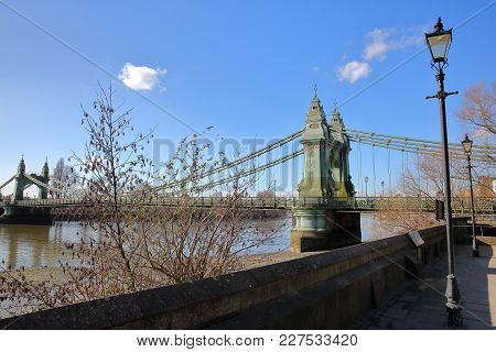 The Thames Path With Hammersmith Bridge In The Background, Borough Of Hammersmith And Fulham, London