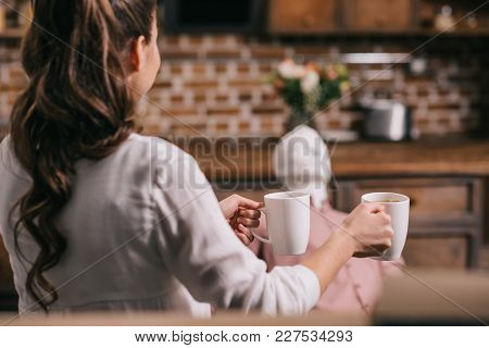 Back View Of Woman Serving Coffee To Manikin At Home, Perfect Relationship Dream Concept