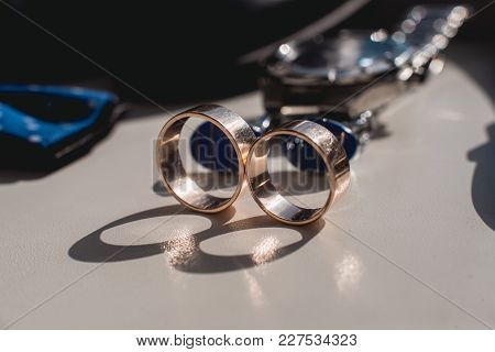 Wedding Rings. Black Leather Shoes, Watch, Blue Bow Tie And Cufflinks, On A White Window Sill. Acces