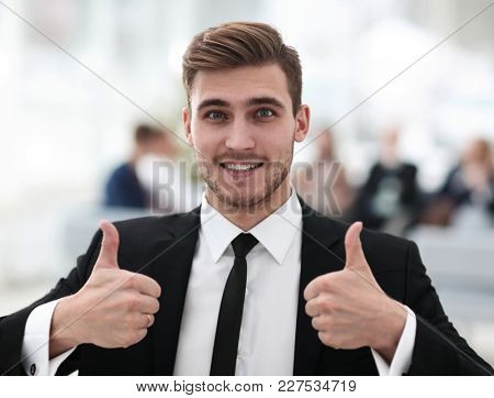 successful businessman showing thumbs up.