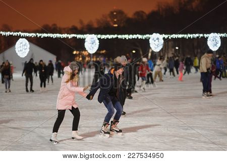 ST. PETERSBURG, RUSSIA - JANUARY 21, 2018: People on the public skating rink in the central park on Elagin island. There is dozens of public skating rink in the city, including few free of charge