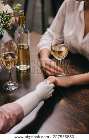 Cropped Shot Of Woman And Mannequin Holding Hands At Table With Glasses Of Wine, Unrequited Love Con