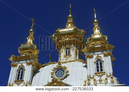 PETERHOF, ST. PETERSBURG, RUSSIA - JUNE 4, 2017: East Chapel flanking the central buildings of Grand Peterhof Palace. The palace along with the city center is recognized as a UNESCO World Heritage