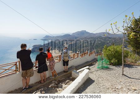 ARCHANGELOS, RHODES ISLAND, GREECE - OCTOBER 11, 2017: People admire the landscape from the Tsambika church. The church of Virgin Mary situated on the top of Zambiki mount