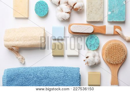 Flat lay composition with soft towel and bath accessories on white background