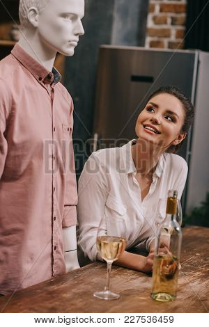 Smiling Woman Looking At Mannequin At Table With Wineglasses At Home, Perfect Relationship Dream Con