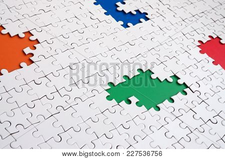 Close-up Texture Of A White Jigsaw Puzzle In Assembled Condition With Missing Elements, Under Which