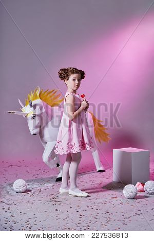 Romantic Child Girl In Design Dress. Pretty Kid Girl Elegant In Pink Dress Make-up Eats A Little Lol