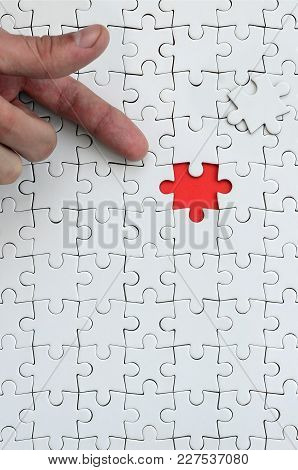 The Texture Of A White Jigsaw Puzzle In The Assembled State With One Missing Element, Forming A Red