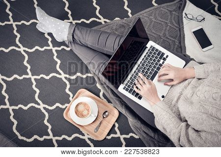 Young Creative Woman Sitting In The Floor And Working With Laptop, Cup Of Coffee And Mobile Phone, T