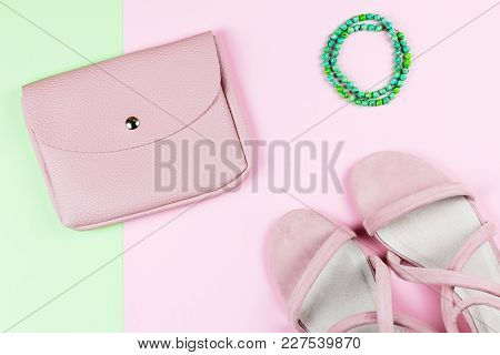 Woman Purse, Heeled Sandals And Jewelry On Pastel Background. Top View