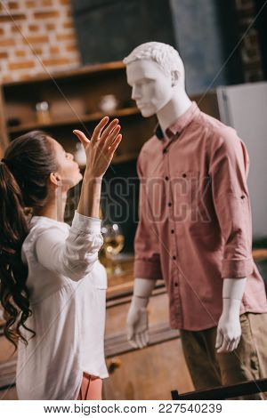 Selective Focus Of Young Woman Having Argument With Manikin, One Way Love Or Loneliness Concept