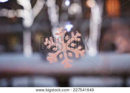 Beautiful decorative snowflake on window glass