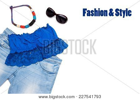 Trendy Summer Outfit Of Jeans, Bandeau Top, Necklace And Sunglasses On White. Fashion & Style Backgr