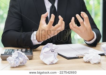 Stressed Or Angry Businessman Make A Mistake With Chewed Paper - Migraine Or Headache Concept.