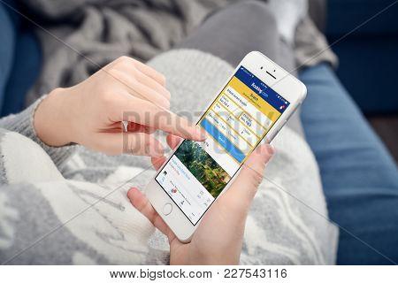 Woman Using Booking.com App
