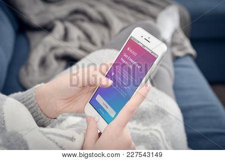 Woman Using A  Apple Music App