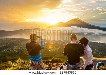 Group Of Young People Watch The Dawn