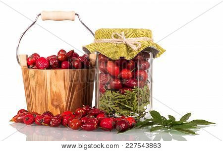 Rosehip Fruits In Wooden Bucket And Jar, Scattered Next, Isolated On White Background