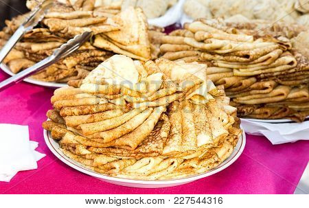 Russian Traditional National Food. Appetizing Fried Pancakes On The Pancake Week
