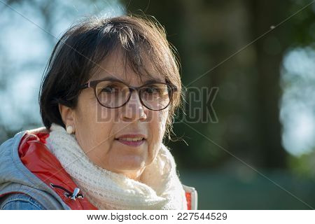Portrait Of A Middle-aged Woman In The Spring Sun