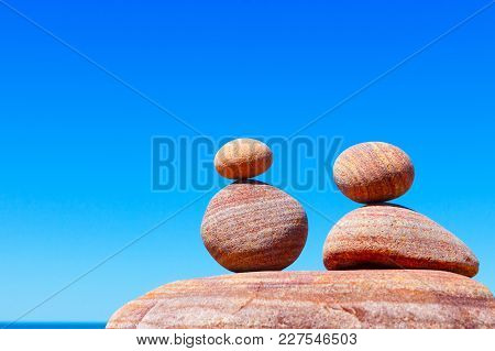 Double Red Rock Zen On The Background Of Summer Sea. Concept Of Harmony, Balance And Meditation