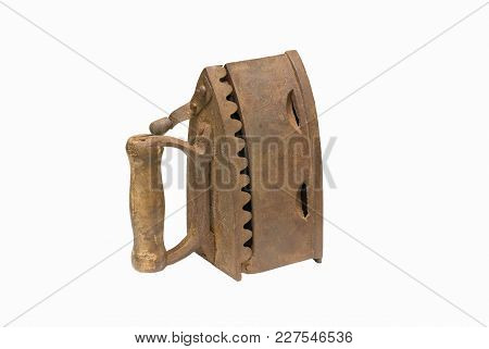 A Very Old Charcoal Iron Isolated On A White Background.