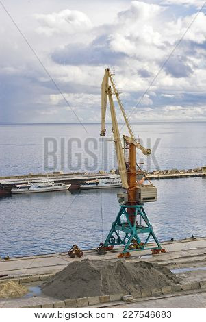 Lonely Crane In Yalta Port Of Discharge .