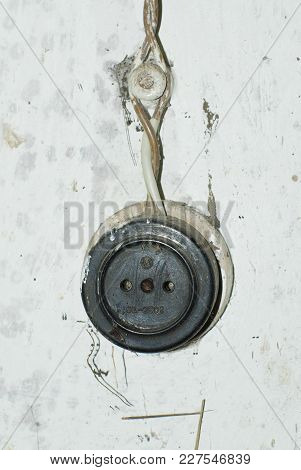 A Very Old Wall Outlet Closeup .