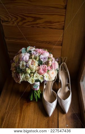 Wedding Bouquet With Pink Peony, Yellow, Pink Roses And Greenery With Elegant Bridal Shoes. Wedding